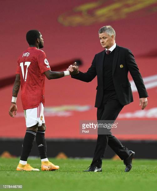 Ole Gunnar Solskjaer Manager of Manchester United shakes hands with Fred of Manchester United following the Premier League match between Manchester...