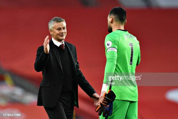 Ole Gunnar Solskjaer Manager of Manchester United shakes hands with Hugo Lloris of Tottenham Hotspur following the Premier League match between...