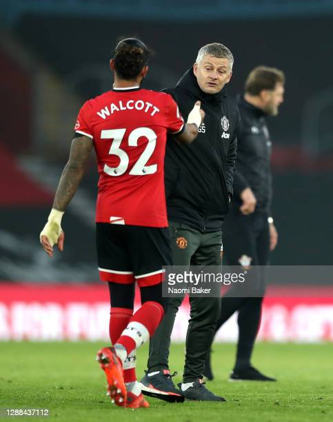 Ole Gunnar Solskjaer Manager of Manchester United shakes hands with Theo Walcott of Southampton after the Premier League match between Southampton...