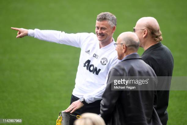 Ole Gunnar Solskjaer, Manager of Manchester United speaks to Avram Glazer , owner of Manchester United prior to a training session ahead of their...