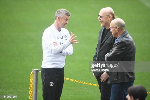 Ole Gunnar Solskjaer, Manager of Manchester United speaks to Avram Glazer, owner of Manchester United prior to a training session ahead of their...