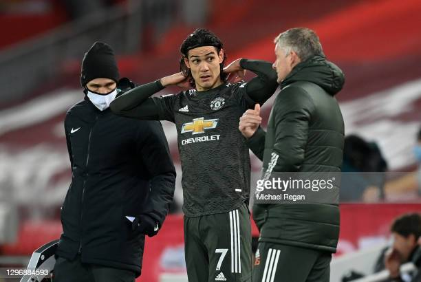 Ole Gunnar Solskjaer, Manager of Manchester United speaks with Edinson Cavani of Manchester United before entering the pitch as a substitute during...