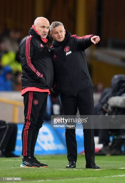 Ole Gunnar Solskjaer, Manager of Manchester United speaks with Mike Phelan, Assistant Manager of Manchester United during the Premier League match...