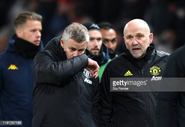 Ole Gunnar Solskjaer, Manager of Manchester United speaks with Assistant Manager Mike Phelan during the Premier League match between Manchester...