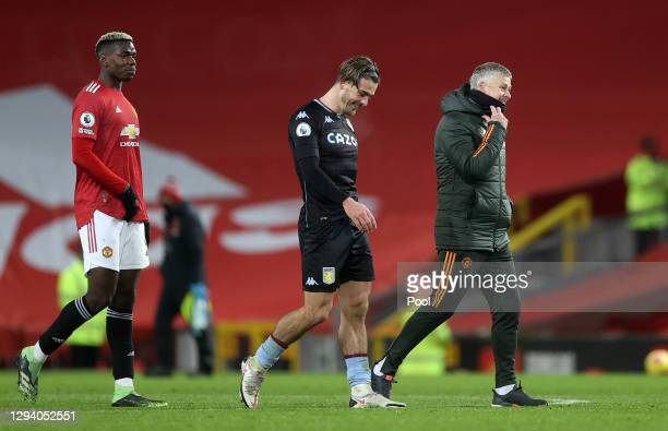Ole Gunnar Solskjaer, Manager of Manchester United talks to Jack Grealish of Aston Villa following the Premier League match between Manchester United...