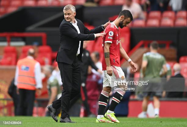Ole Gunnar Solskjaer, Manager of Manchester United with Bruno Fernandes after the Premier League match between Manchester United and Aston Villa at...