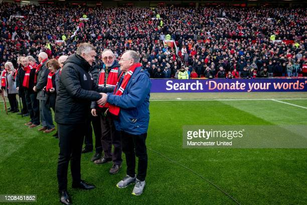 Ole Gunnar Solskjaer manger of Manchester United greets the 'Guests of Honour' ahead of the Premier League match between Manchester United and...