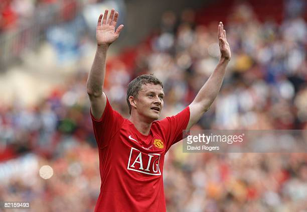 Ole Gunnar Solskjaer of Manchester United acknowledges the crowd after his testimonial friendly match between Manchester United and Espanyol at Old...