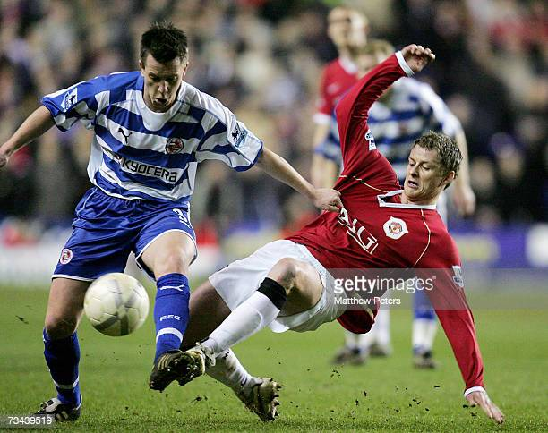 Ole Gunnar Solskjaer of Manchester United clashes with Nicky Shorey of Reading during the FA Cup sponsored by EON Fifth Round Replay match between...