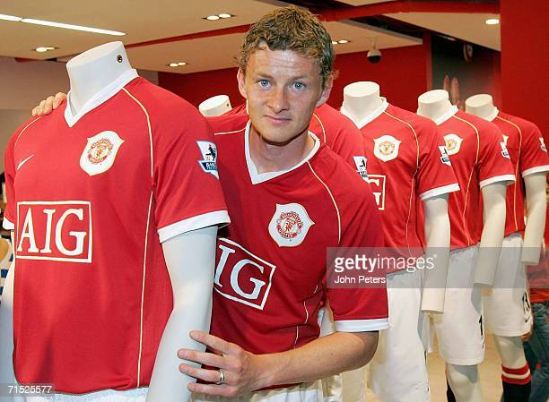 Ole Gunnar Solskjaer of Manchester United poses in the new home shirt at the Official launch of the new Manchester United home kit in the Megastore...