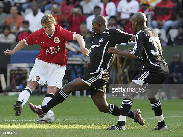 Ole Gunnar Solskjaer of Manchester United scores the first goal during the match against Orlando Pirates as part of their preseason tour of South...
