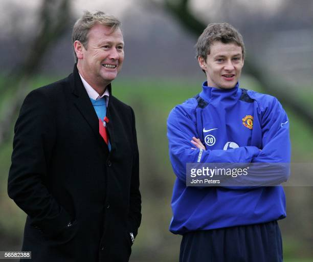 Ole Gunnar Solskjaer of Manchester United watches from the sidelines with Norway national manager Age Hareide during a first team training session at...