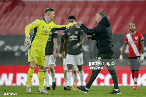 Ole Gunnar Solskjaer of Manchester United with Dean Henderson after their side's 32 win during the Premier League match between Southampton and...