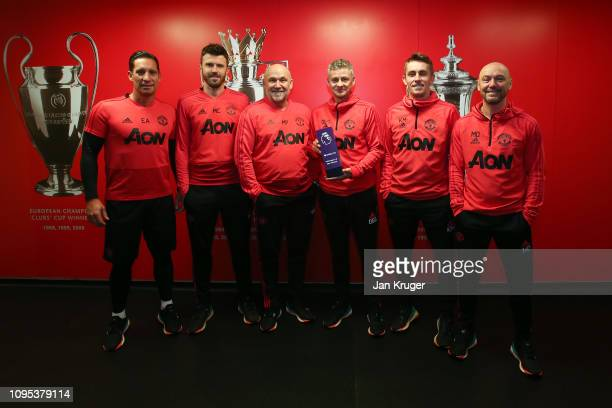 Ole Gunnar Solskjaer poses with his Barclays manager of the month award and coaching staff at Aon Training Complex on February 07 2019 in Manchester...