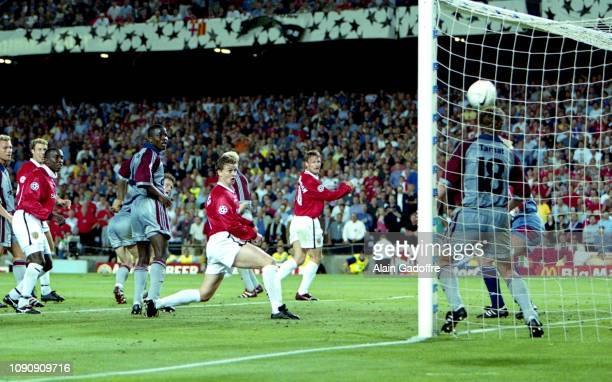 Ole Gunnar Solskjaer scores his second side's goal during the UEFA Champions league final match between Manchester United and Bayern Munich on May 26...