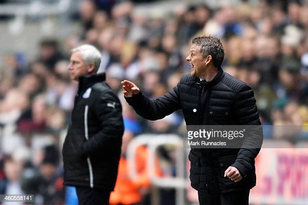 Ole Gunnar Solskjaer the Cardiff manager directs his players as Alan Pardew the Newcastle manager looks on during the Budweiser FA Cup third round...