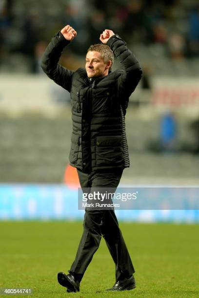 Ole Gunnar Solskjaer the Cardiff manager salutes the fans following their tam's 21 victory during the Budweiser FA Cup third round match between...