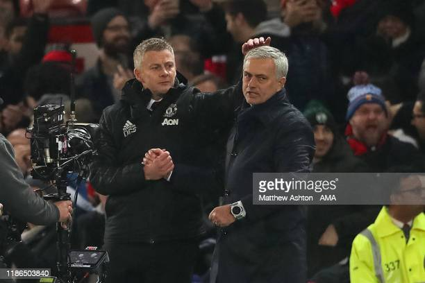 Ole Gunnar Solskjaer the head coach / maanager of Manchester United consoles Jose Mourino the head coach / manager of Tottenham Hotspur walks off...