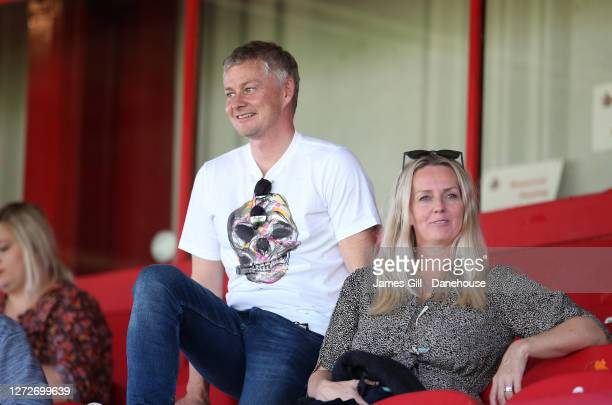 Ole Gunnar Solskjaer the manager of the Manchester United first team and his wife Silje Solskjaer watch their daughter Karna Solskjaer play for...