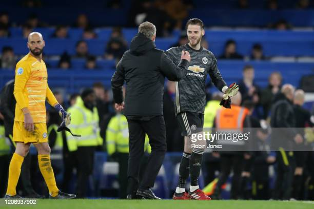 Ole Gunnar Solskjaer with David De Gea of Manchester United after their sides 20 win during the Premier League match between Chelsea FC and...