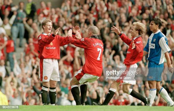 Ole Gunnar Solskjær of Manchester United celebrates with teammate Eric Cantona after scoring a goal during the FA Carling Premiership match between...