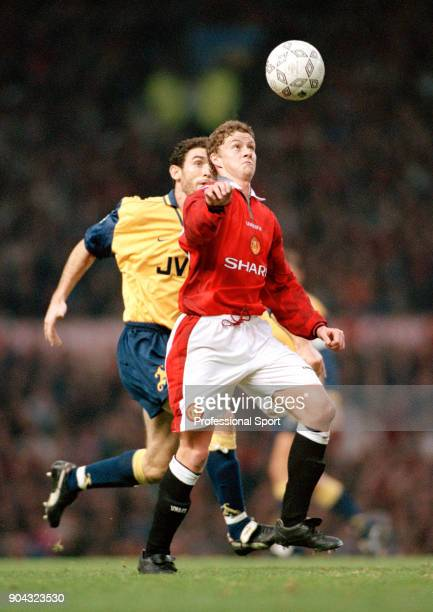Ole Gunnar Solskjær of Manchester United is tracked by Martin Keown of Arsenal during an FA Carling Premiership match at Old Trafford on November 16...