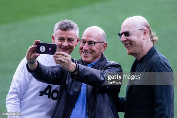 Ole Gunnar Solskjr takes a selfie with Avram Glazer owner of Manchester United during the training session before the second leg Champions League...