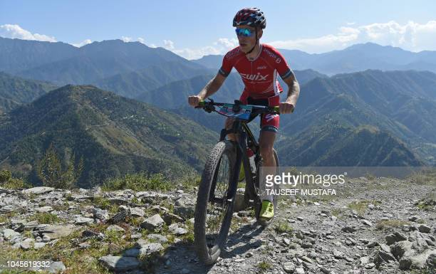 Ole Hem of Norway competes in the 14th edition of the Hero MTB Himalaya mountain bike race in the northern Indian state of Himachal Pradesh on...