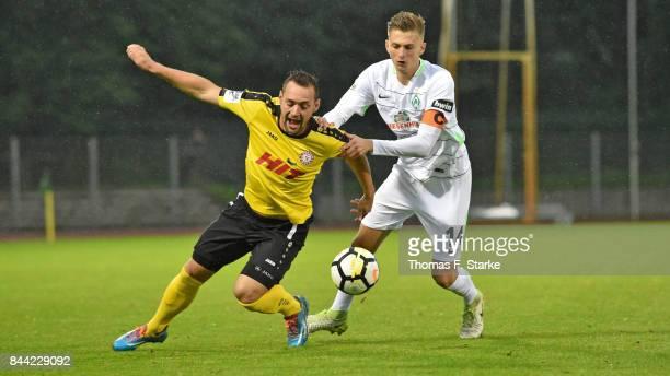 Ole Kaeuper of Bremen tackles Maik Kegel of Koeln during the 3 Liga match between SV Werder Bremen II and SC Fortuna Koeln at Platz 11 stadium on...