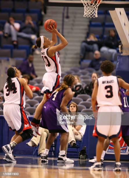 Ole Miss' #40 Danetra Forrest shoots a jumper over a TCU defender in the first half of the firstround game at the Hartford Civic Center in Hartford...