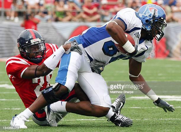 Ole Miss cornerback Nate Banks tackles Memphis wide receiver Maurice Jones at VaughtHemingway Stadium on September 3 2006