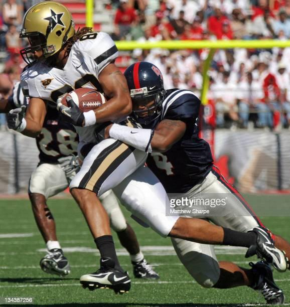 Ole Miss defenisve back Bryan Brown tackles Vanderbilt wide receiver Marlon White at VaughtHemingway Stadium in Oxford Mississippi October 7 2006
