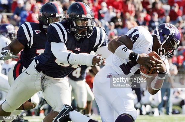 Ole Miss defensive end Greg Hardy brings down Northwestern State quarterback Germayne Edmond at Vaught-Hemingway Stadium in Oxford, Miss. On November...