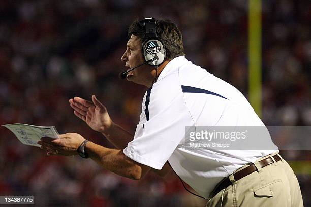 Ole Miss head football coach Ed Orgeron calls in a play from the sidelines against Georgia at Vaught-Hemingway Stadium in Oxford, Miss. On September...