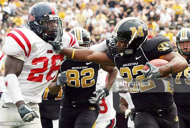 Ole Miss linebacker Garry Pack and Missouri running back Tony Temple share blows to the facemask during the game between the Mississippi Rebels and...