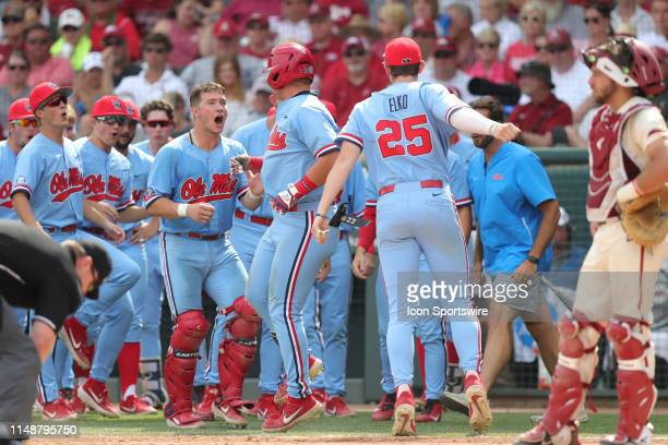 Ole Miss players celebrate the home run hit by third baseman Tyler Keenan in Game 2 of the NCAA Super Regional between the Ole Miss Rebels and the...