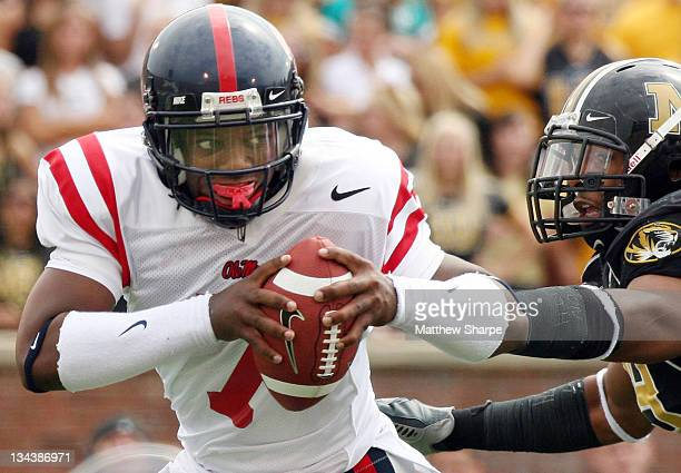 Ole Miss quarterback Brent Schaeffer scrambles from a Missouri player during the game between the Mississippi Rebels and the Missouri Tigers at...