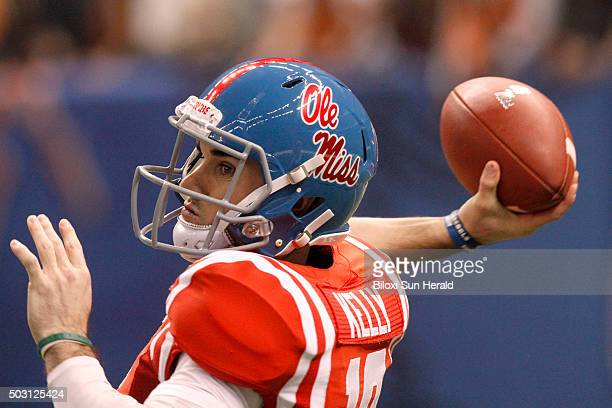 Ole Miss quarterback Chad Kelly looks downfield for a receiver against Oklahoma State in the first half of the Sugar Bowl at the MercedesBenz...