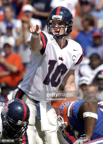 Ole Miss quarterback Eli Manning signals a play at Ben Hill Griffin Stadium in Gainesville Ole Miss upset the Gators 20 17