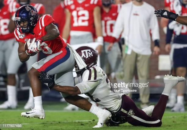Ole Miss Rebels wide receiver Elijah Moore tries to break a tackle from Texas AM Aggies defensive Clifford Chattman during the game between the Texas...