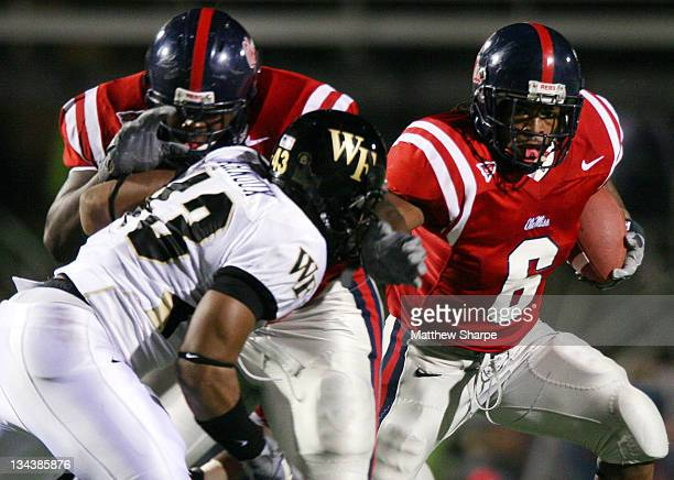 Ole Miss running back BenJarvus Green-Ellis gets a block from his offensive line against Wake Forest at Vaught-Heminway Stadium in Oxford, Miss. On...