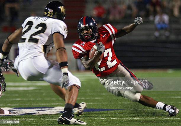 Ole Miss wide receiver Dexter McCluster attempts to outrun Wake Forest free safety Josh Gattis at Vaught-Hemingway Stadium in Oxford, Miss. On...