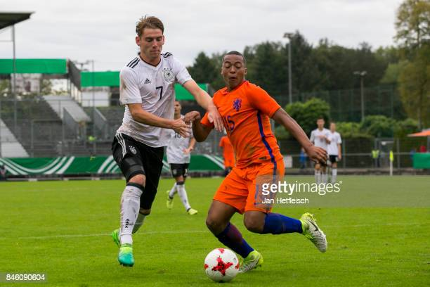 Ole Pohlmann of Germany and Nordin Musampa of the Netherlands battle for the ball during the 'Four Nation' match between U17 Germany and U17...