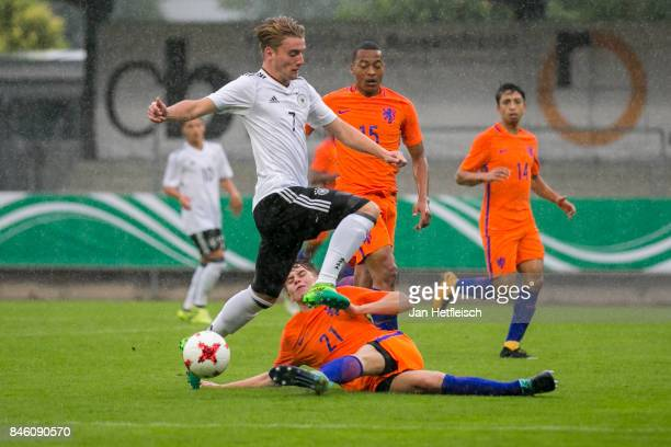Ole Pohlmann of Germany and Ramon Hebdriks of the Netherlands fight for the ball during the 'Four Nation' match between U17 Germany and U17...