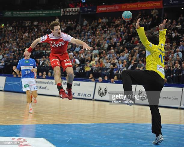 Ole Rahmel of Essen throws a goal during the DKB Bundesliga handball game between HSV Hamburg and TUSEM Essen at O2 World on April 17 2013 in Hamburg...