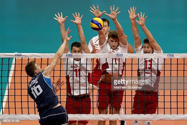 Oleg Antonov of Italy spikes the ball against Fabian Drzyzga Piotr Nowakowski and Michal Kubiak of Poland during the FIVB World League Group 1 Finals...
