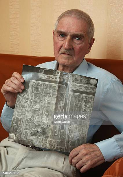 Oleg Chichkov a former Chernobyl 'liquidator' holds an aerial photo of the Chernobyl nuclear power plant taken several weeks after the explosion on...