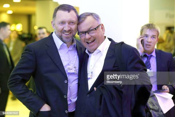 Oleg Deripaska billionaire and chief executive officer of United Co Rusal left and Andrey Kostin chief executive officer of VTB Group react as they...