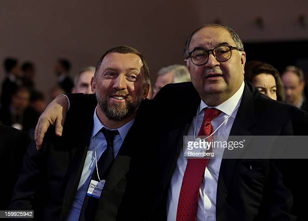 Oleg Deripaska chief executive officer of United Co Rusal left smiles with Russian billionaire Alisher Usmanov before the opening keynote speech on...