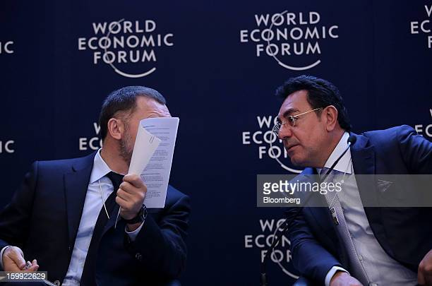 Oleg Deripaska chief executive officer of United Co Rusal left speaks with Samir Brikho chief executive officer of Amec Plc during a forum session on...